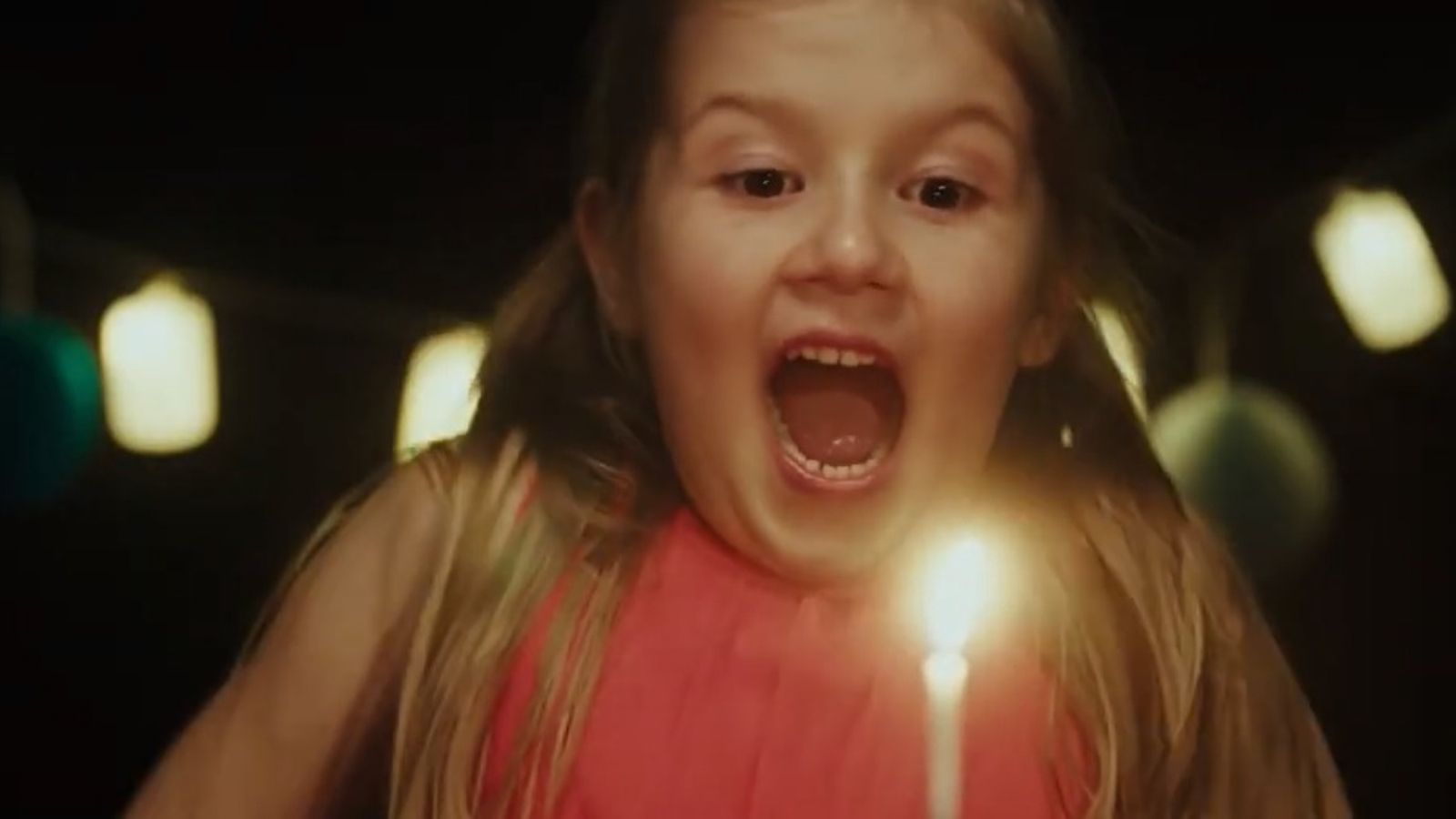 Girl blows out birthday candle