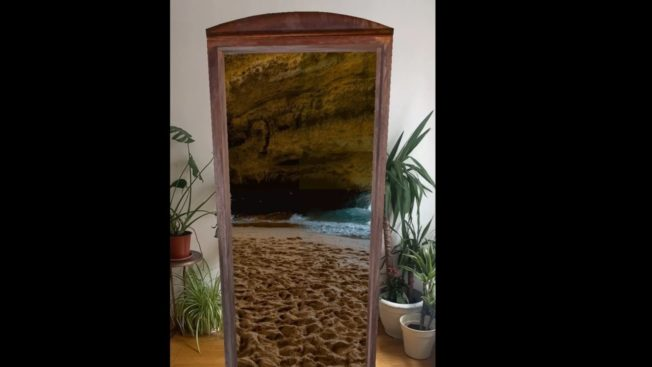 An AR doorway takes the user to a beach cove