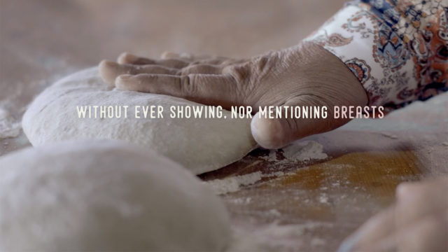 A hand kneading bread dough with the caption,
