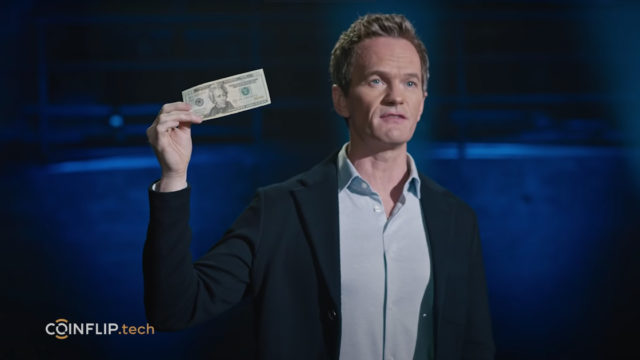 Neil Patrick Harris holds up a note