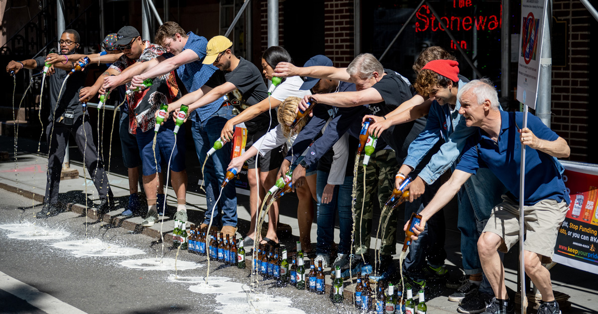 people pouring out beer at stonewall inn in protest of beer company