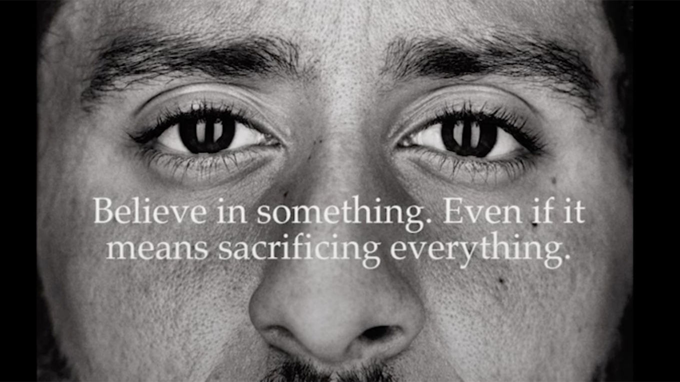 Colin Kaepernick's face appears behind the text Believe in something. Even if it means sacrificing everything.