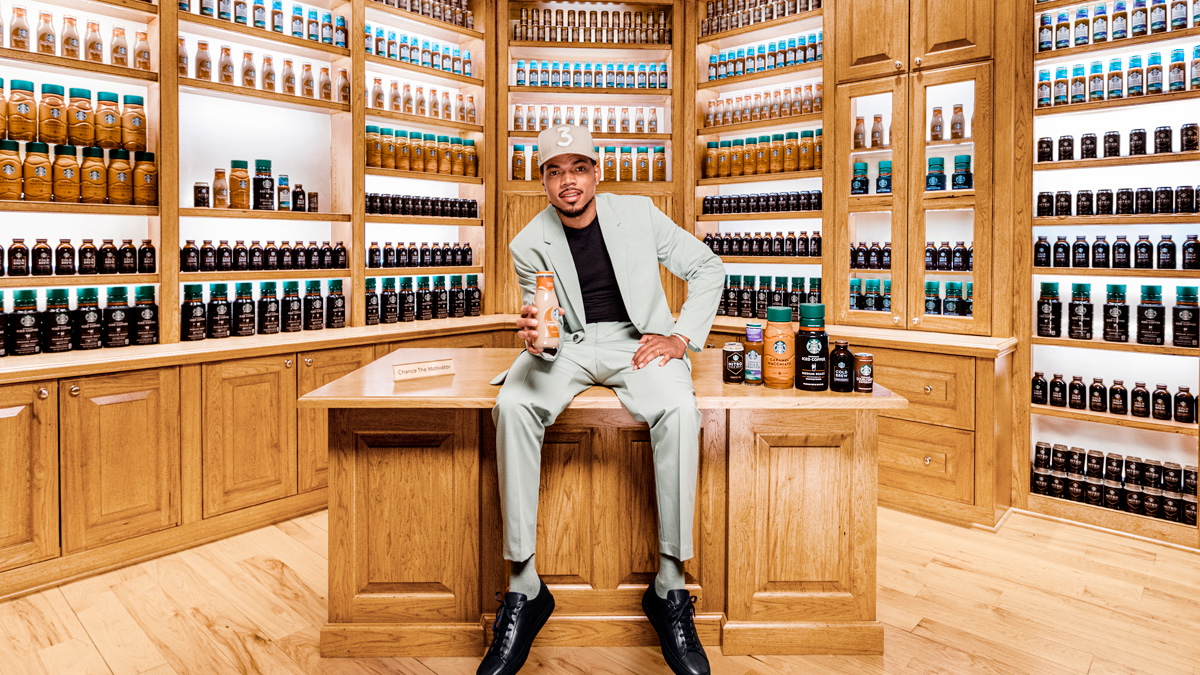 Chance the Rapper with shelves filled with Starbucks' Ready To Drink products