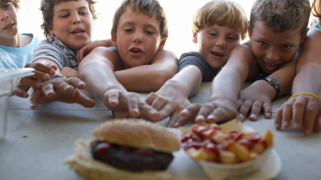 Kids reach for bugers and chips