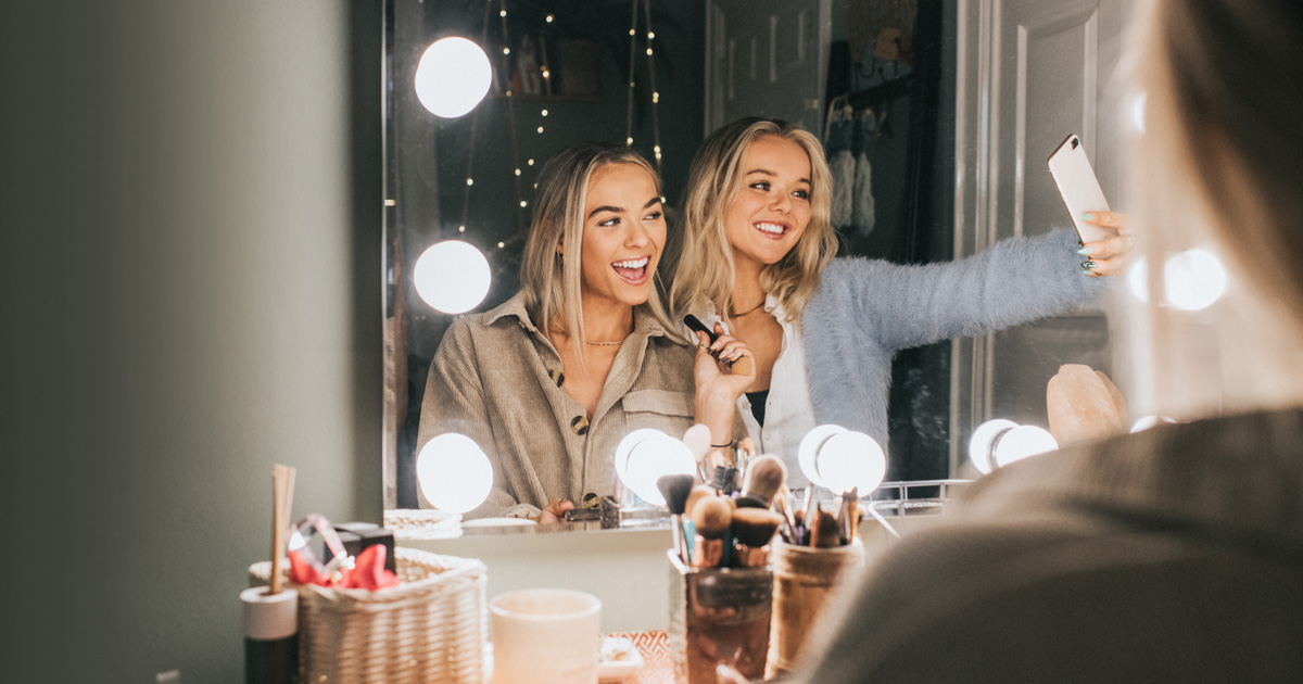 Two women smile for a selfie