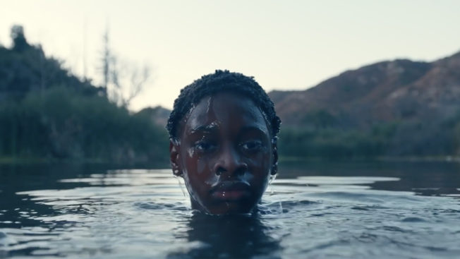 A young boy rises out of a lake in the You Love Me ad