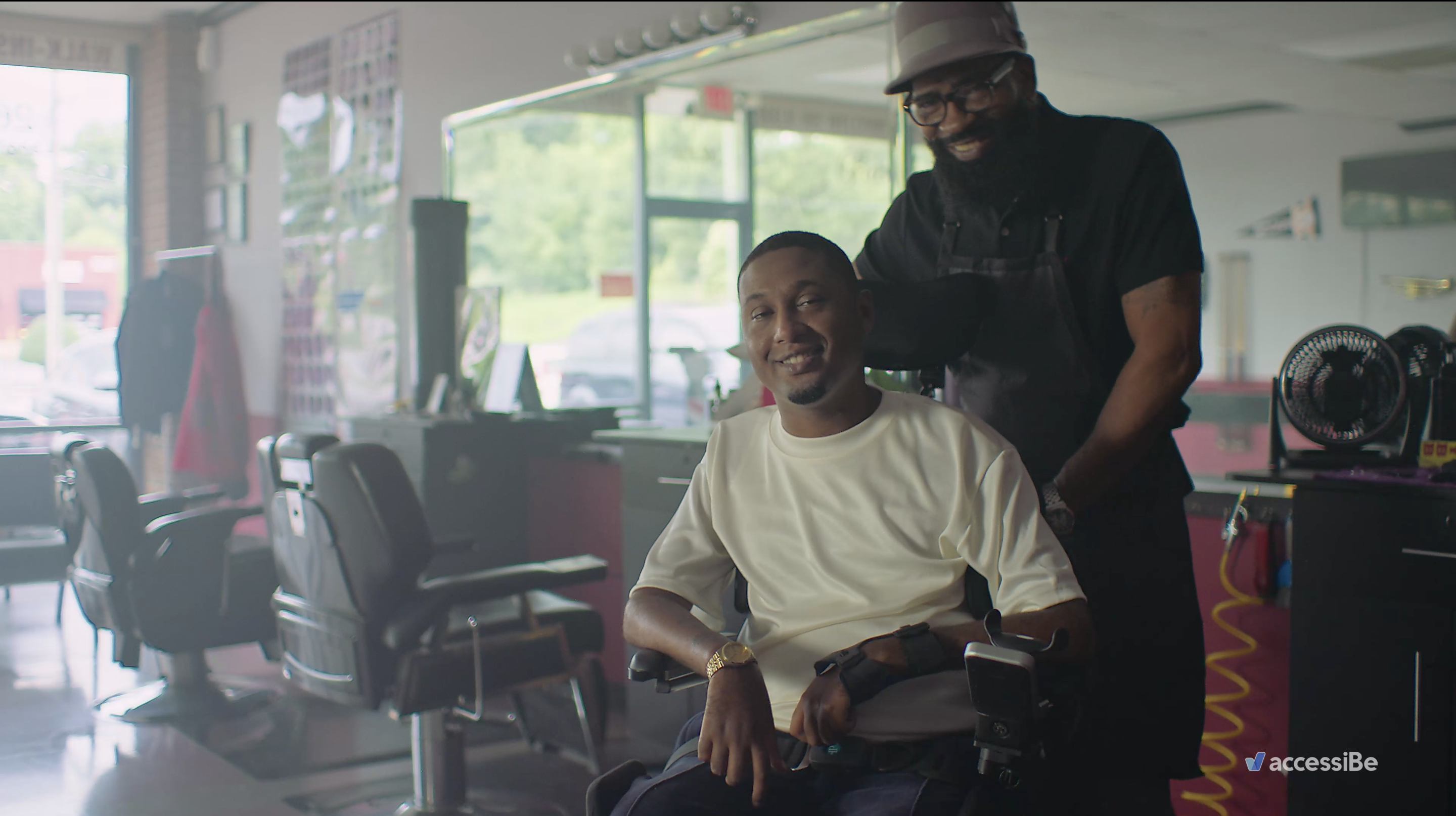 A man in a wheelchair sits in a barbershop