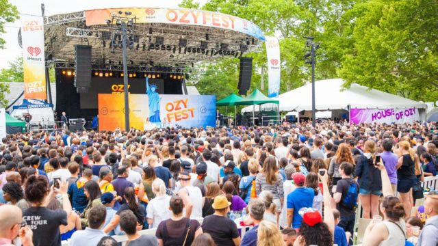 A large crowd in front of an outdoor stage