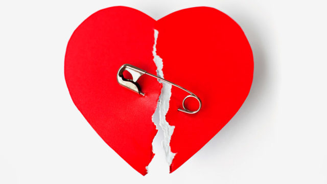 broken heart held together by a safety pin