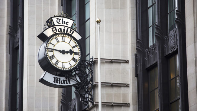 A clock is shown outside the Daily Mail office