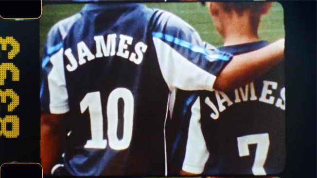 A behind shot of two young soccer players standing next to each other