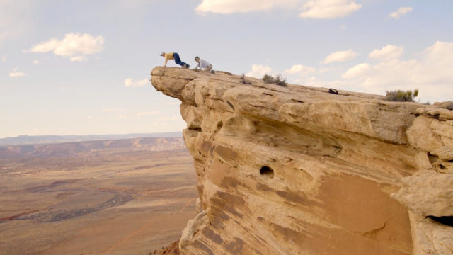 Two people exploring a cliff