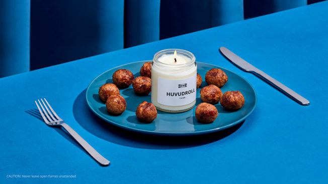 Meatballs surrounding a candle on a plate
