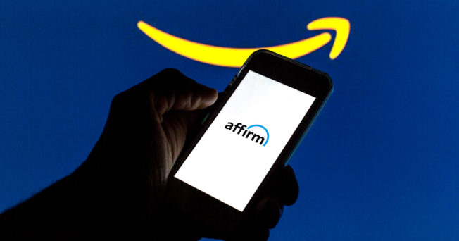 a hand holding a phone with Affirm on the screen