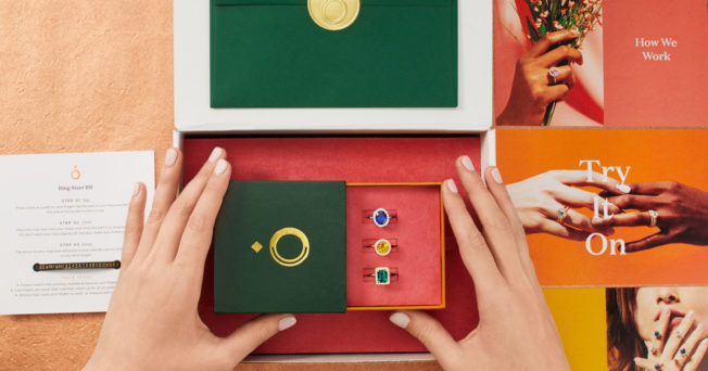 hands holding a jewelry box full of rings