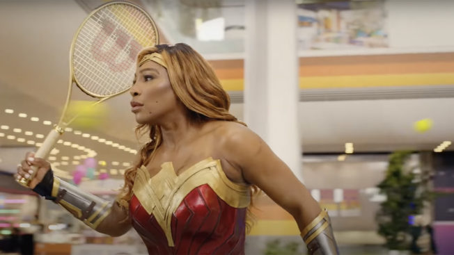Serena Williams holds a tennis racquet while dressed as Wonder Woman