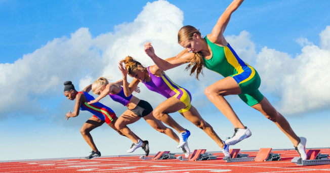Runners race on a track