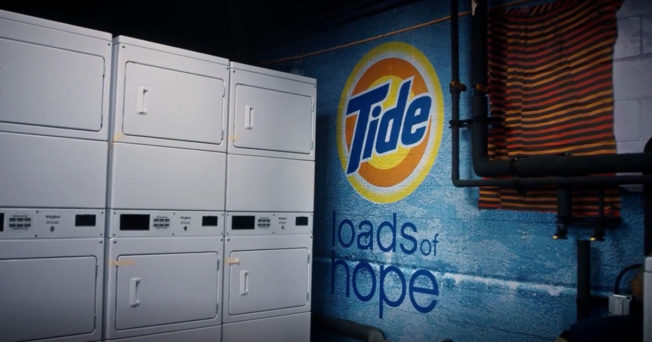 a laundry room with tide