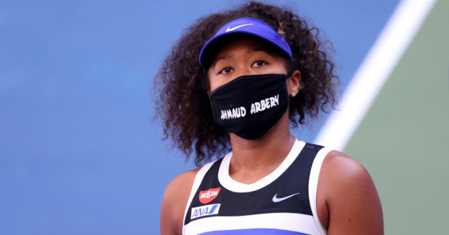 Tennis player Naomi Osaka wears a mask with Ahmaud Arbery's name on it during the 2020 U.S. Open