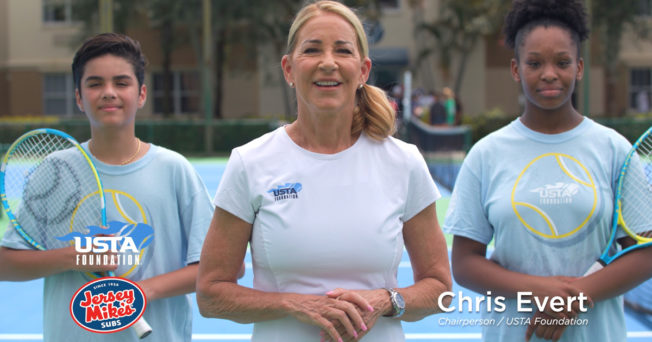 Tennis superstar Chris Evert and tennis students in an ad for Jersey Mike's and the USTA Foundation