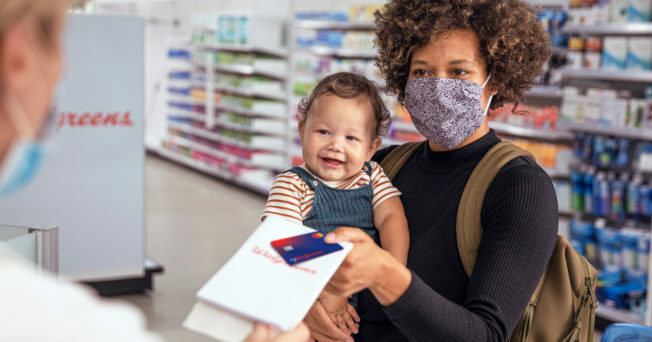 a mom and her baby at the pharmacy