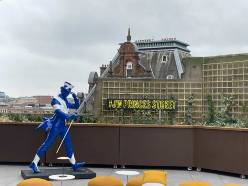 A Saltire emblazoned Striding Man on the rooftop at the Johnnie Walker Princes Street Experience.