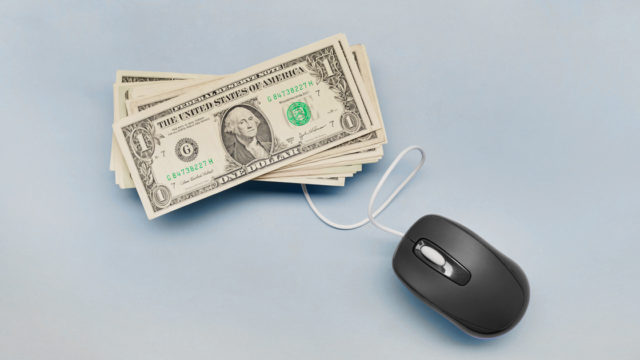 a mouse connected to dollar bills