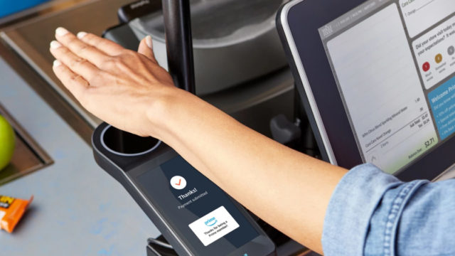 a person holding their hand over a palm scanner