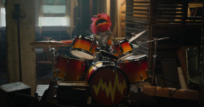 Animal playing drums in the attic