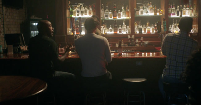 people sitting at a bar