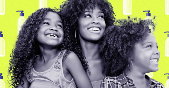 A Black mother and her two daughter smiling with a neon green background with haircare products.