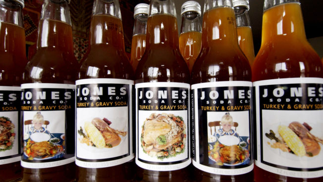 Bottles of Jones Soda Turkey and Gravy flavor are lined up next to each other