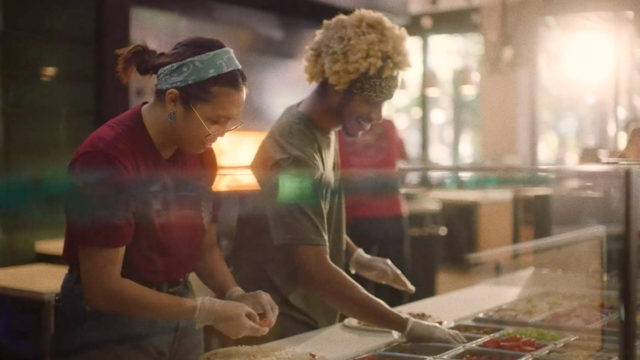 Employees working at a MOD Pizza location