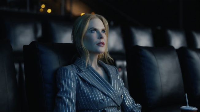 Nicole Kidman sits in an empty theater watching a film off camera