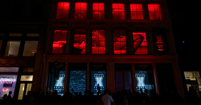 Building with red-lit windows and silhouettes