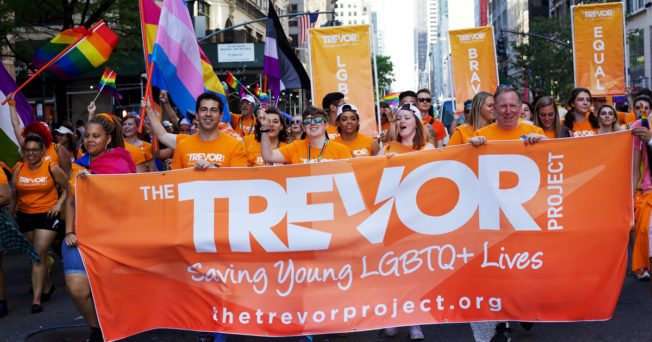 Pride Parade marchers with Trevor Project banner