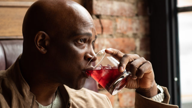a man drinking a cocktail