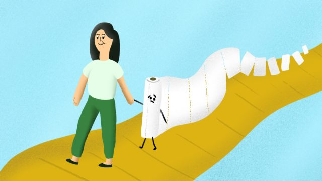 a woman holding hands with a roll of paper towels