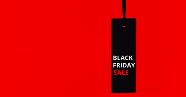 Graphic of a black sign that says BLACK FRIDAY SALE. Background is red.