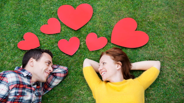 Five Relationship Questions to Apply to Fix the Client-Agency Dynamiche grass, smiling and looking into each others' eyes. Red hearts all around them.