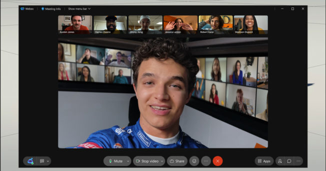 A McLaren team member uses Webex to communicate with a group of people online